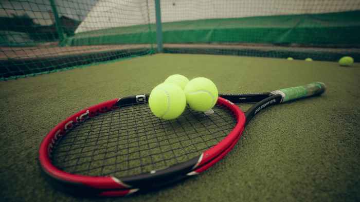 tennis-balls-and-racket-on-the-grass-court_sp8rz-fdl_thumbnail-full01
